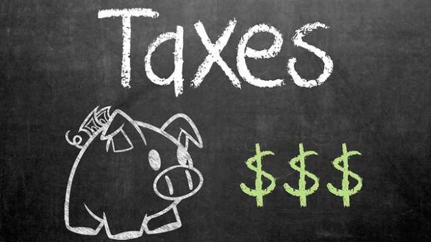 """Taxes"" by GotCredit licensed under CC BY 2.0"