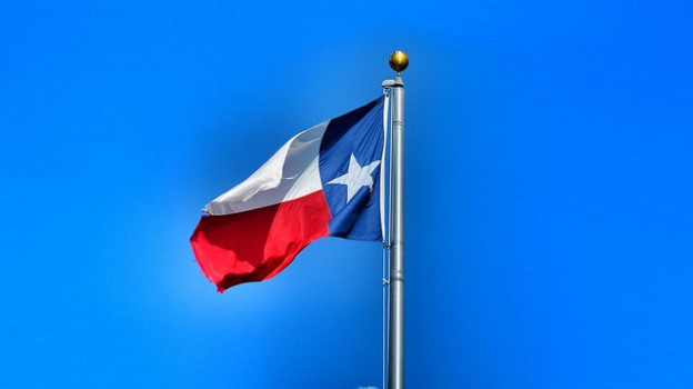 """Our Beautiful State Flag Against Our Big Blue Sky"" by Texas State Library and Archives Commission licensed under CC BY 2.0"