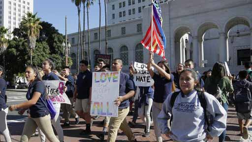 FILE - In this Monday, Nov. 14, 2016 file photo, East Los Angeles high school students protest against the election of President-elect Donald Trump outside Los Angeles City Hall. Mixed signals from the White House on gay rights and conscience protections have put two constituencies on edge: LGBT advocates already wary of President Donald Trump and religious conservatives determined to hold him to his campaign promises. (AP Photo/Nick Ut)