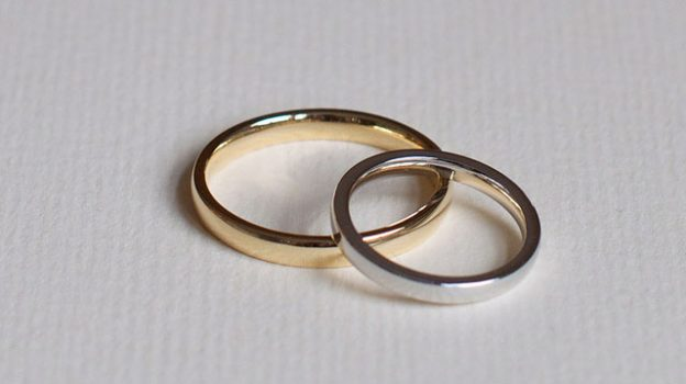 """Our Wedding Rings"" by Nick Webb licensed under CC BY 2.0"